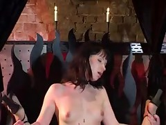 Master whips two hot submissive girls in a dungeon
