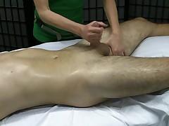 Kinky girl gives a handjob during a massage