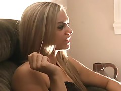Sexy teen blonde is smoking a cigarette
