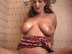 Chick with a priceless rack masturbating in the baths