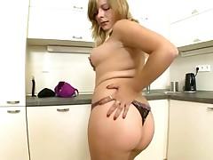 Chunky cutie undresses and masturbates in kitchen