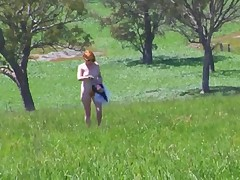 Redhead flashing her pussy and tits in public garden