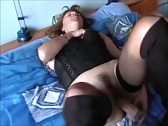 MILF fucking her wet cunt with a dildo and masturbates