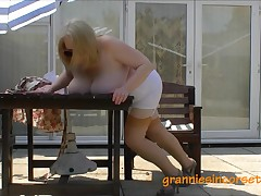 Granny in her corset getting some sun