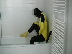 Girl in yellow spandex uniform has orgasm in bathroom