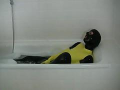 Girl in yellow spandex uniform has orgasm in bathroom