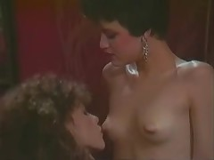Blonde lesbian has fun with a retro brunette babe