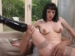 European Mature whore rides a hard younger penis