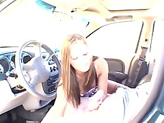 Teen gives a blowjob in the car outdoors