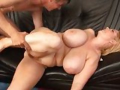 Buxom plumper takes a load of man juice all over her massive melons