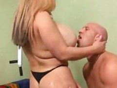 Huge rack blond Crystal has her massive tits glazed with a load of jizz