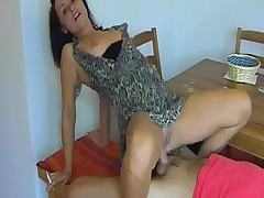 Smoking girl gives footjob, handjob, and rides him
