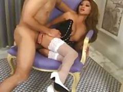 MILF Charmane Star in a bustier and white stockings having sex