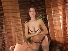 Beautiful brunette fingering in panties and stockings