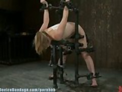 Adrianna Nicole, hands spread less to the air metal bondage, helpless and drooling