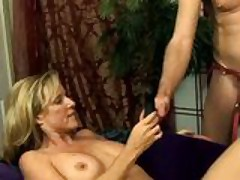 Guy creampies his wife then has to fuck her with a strap on
