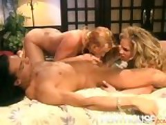 2 Hot Babes Deep Throating a Big Cock and Cum Swapping