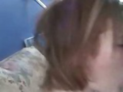 Red head gives a POV blowjob and gets a facial