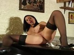 A Raven Haired Chick In Stockings