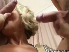 Hot mom fucked by two young