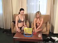 Two girls play strip four in a row