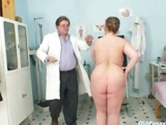 Mature woman examined at the doctors