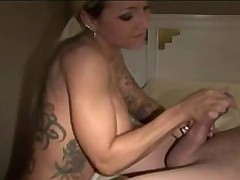 Tatted up blonde bimbo gives handjob