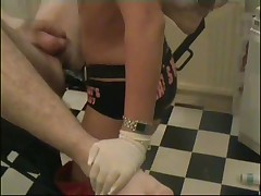 Mistress strap-on fucks slave in gyno chair