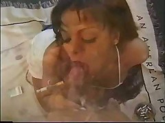 She gives a smoking fetish blowjob