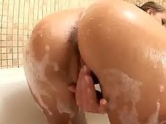 Tan spinner rubs her snug pussy