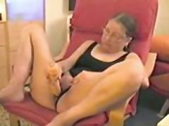 Old wife masturbating with her toy