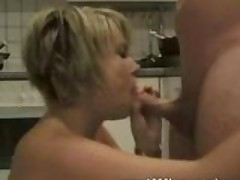 Sucking his cock in the kitchen