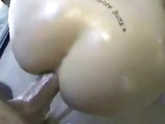 Amateur girl receive a huge cock in her oiled ass