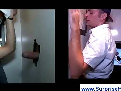 Boy sucks penis at a gloryhole