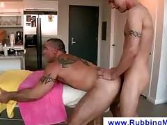 Tattooed guys fucking after a massage