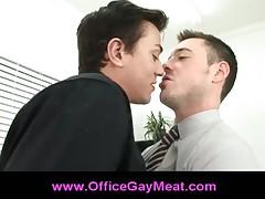 Horny gay business man gives blowjob at the office