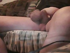 She gives chubby hubby a footjob