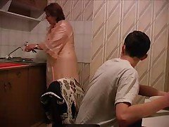 Old women fucked in the kitchen by youngster