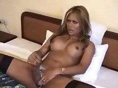 Natalie sexy shemale stroking her clit-cock