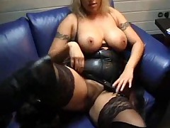 Girl in leather eagerly shows her body