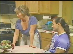 Mature with 2 young men in kitchen