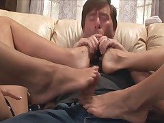 Two blondes giving a kinky footjob in stockings