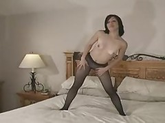Sexy girl in black seamless pantyhose