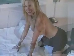 Blonde MILF in crotchless pantyhose fucks