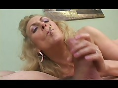 Smoking Granny sucks a broad in the beam cock