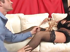 Busty brunette foot fetish and footjob in nylons
