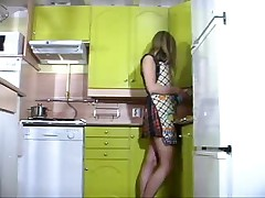Busty Euro Chick Rubs Her Twat in the Kitchen