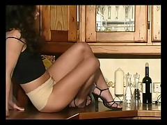 British slut Amanda plays with herself in the kitchen