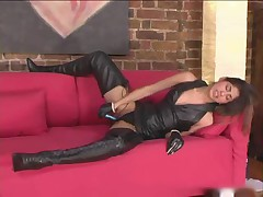 Girl in lots of leather touching sensually
