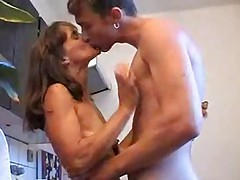 Guy with mom in kitchen